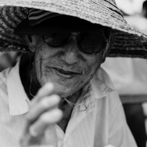 Man wearing straw hat and sunglasses