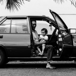 Father and little daughter sitting in car