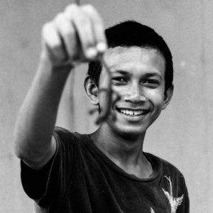 Boy showing lizard