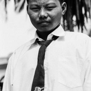 ソンコを被って制服を纏った男の子