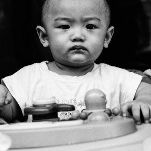 Baby wearing grumpy look