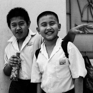 Two school boys smiling