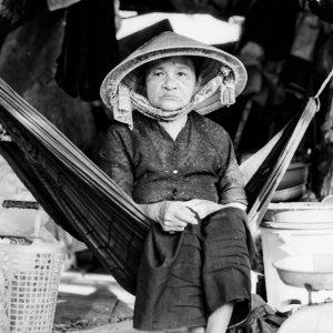 Older woman sitting on hammock