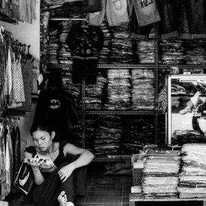 Storekeeper reading magazine