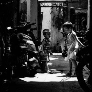 Boys playing in dim lane