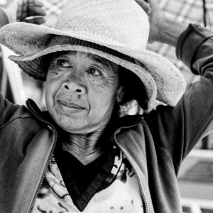 Older woman wearing two hats