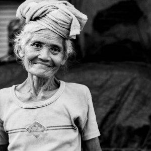 Older woman putting cushion on head