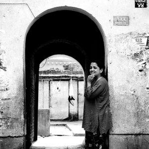 Woman smiling at entrance