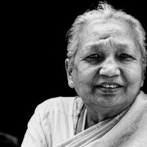 Dainty older woman in Patan
