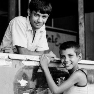 Young man and boy at counter