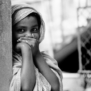 Girl looking while hiding mouth