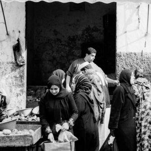 Women buying in street market