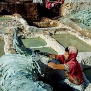 Man working in tanning pit