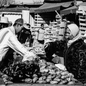 Woman with a hijab buying potatoes