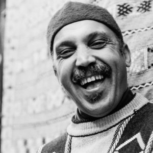 Man with a knit cap laughing