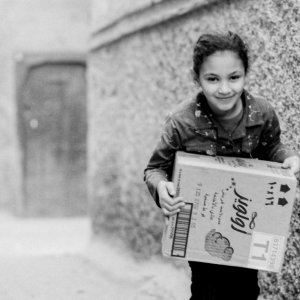 Girl carrying box