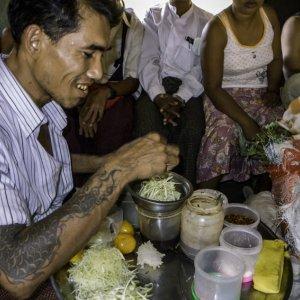 Man selling papaya salad