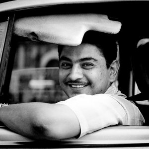 微笑むタクシー・ドライバー