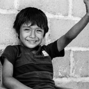 Boy smiling and raising arm