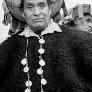Man wearing an ethnic costume like poncho