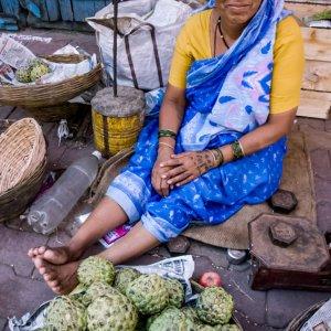 Woman selling custard apples