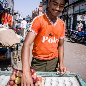 Young man selling apples