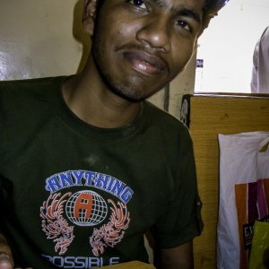 Young man eating fried rice