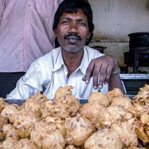 Man selling Pakora in fried food stand