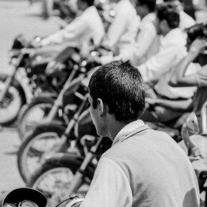 Riders waiting at stoplight