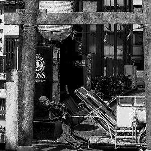 man dragging cart
