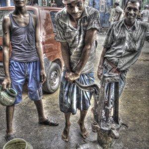 Three men at well