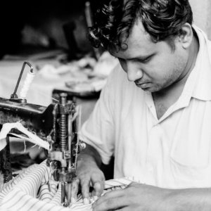 Man sewing with sewing machine