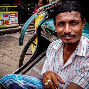 rickshaw wallah wearing striped shirt
