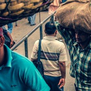 Men carrying burden