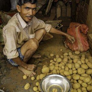 Man selling potatoes