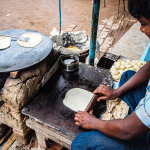 Man cooking Roti