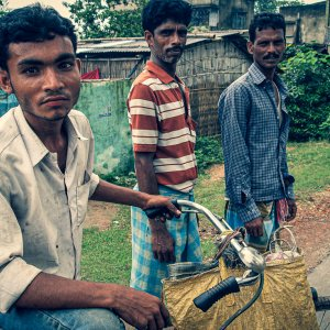 Three men on a country road in Berhampore