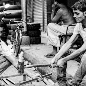 Men cutting scrap irons