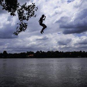 Boy falling into river