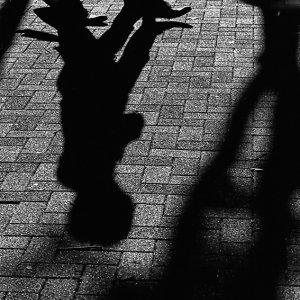 Shadows of pedestrian on ground