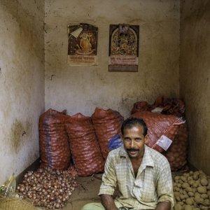 Man selling onion and potato