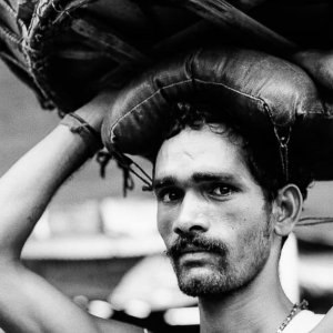 Man carrying with basket on his head