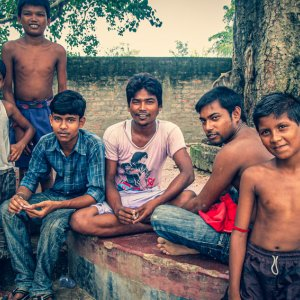 Boys around tree