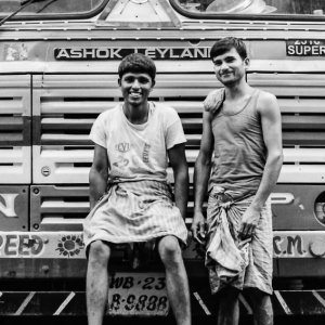 Two men in front of truck