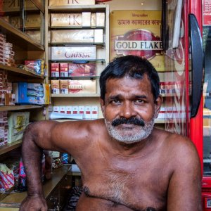 Shirtless tobacconist