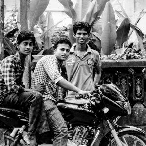 Three men around motorbike