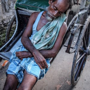 Rickshaw wallah sleeping