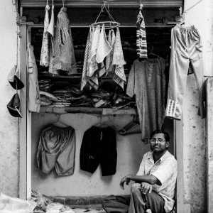 Man selling old clothes