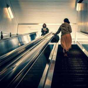 Woman on escaltor