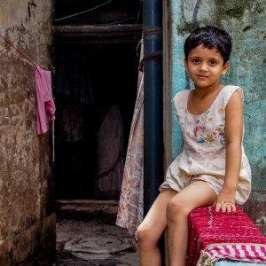 Little girl sitting in lane